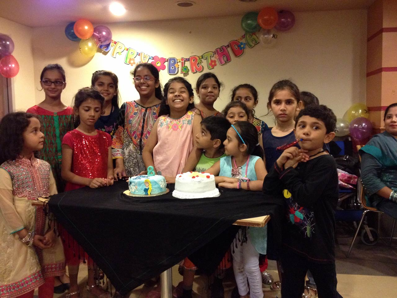 Zara and her friends are having fun with the Happy Birthday Cake