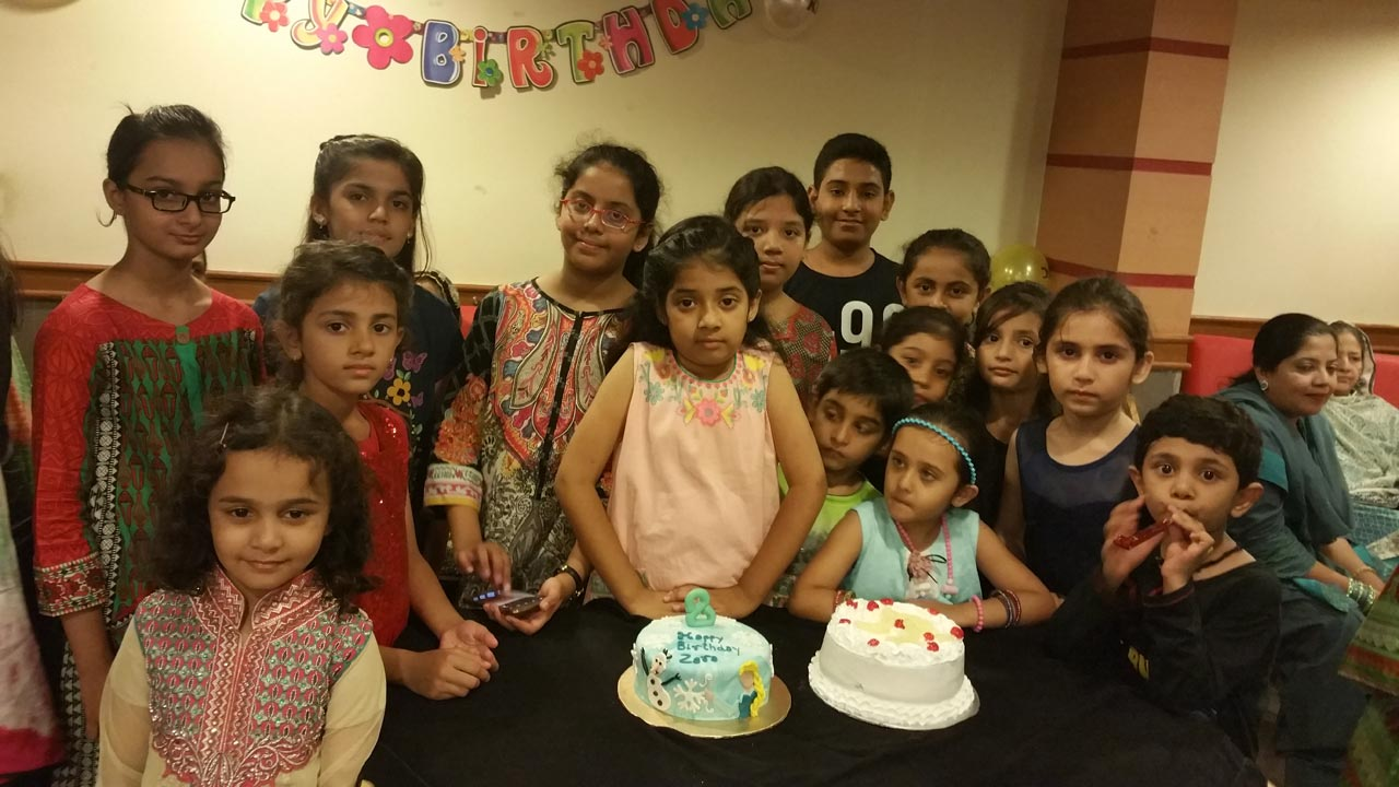 Zara is enjoying with all her friends waiting to cut the cake
