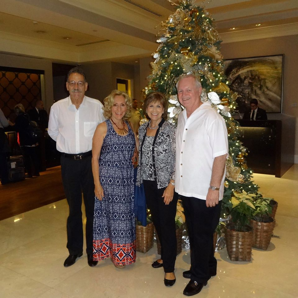 Keith Furones, L Jennifer Simpson, Judy Hallstrom Walker and Bill Walker gather for a pre-Christmas Dhahran Theatre Group celebration.
