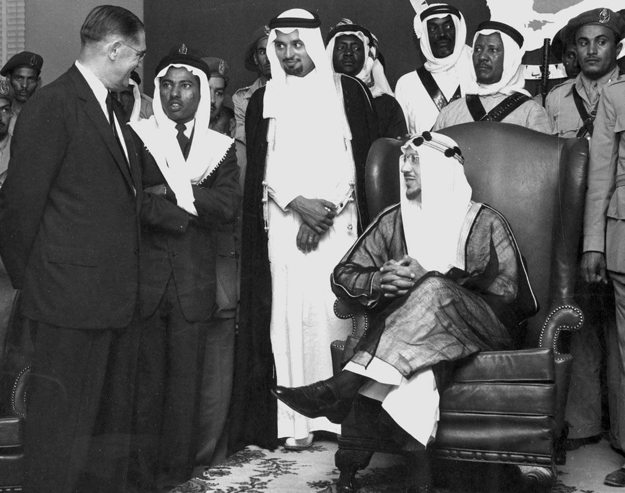 Aramco President Fred Davies talks to King ibn Saud in the Dhahran Dinning Hall in the 1950's