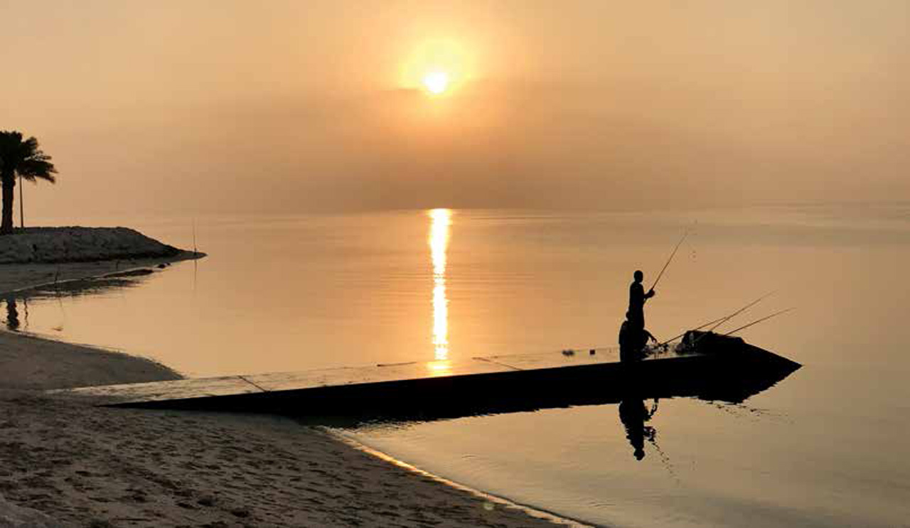 Men Fishing at Sunset
