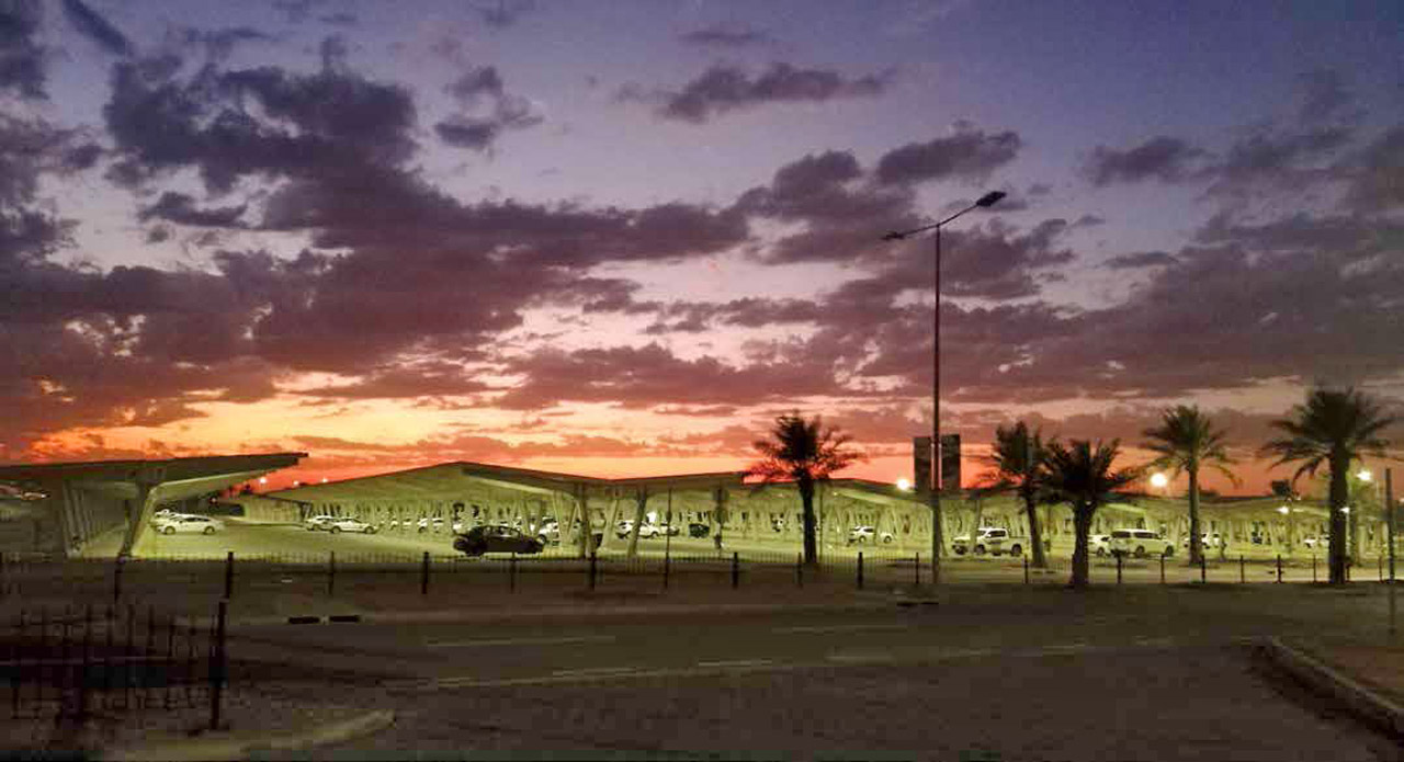The winter sky rising above the Al-Midra Tower parking lot in Dhahran by Mirza Baig.