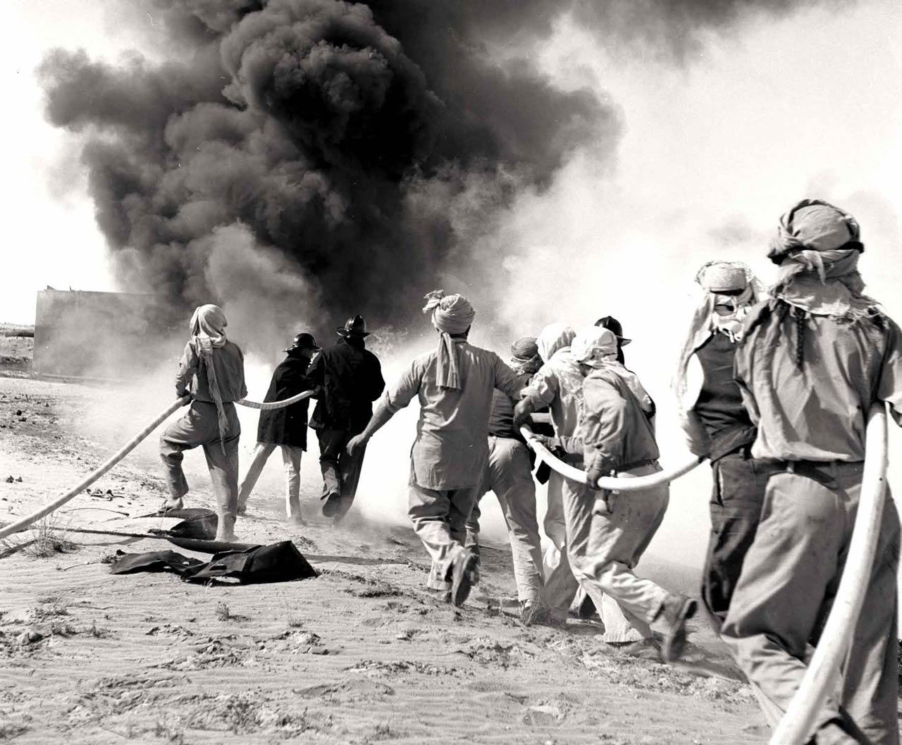 During the 1950s, firefighters practiced their skills in drills at the Dhahran testing ground, lowering accident frequency rates from 42.2 disabling injuries per million work hours in 1947 to 8.2 in 1953. (Photo: T.F. Walters)