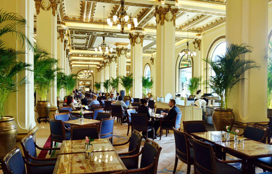 Lunchtime in the lobby of the Peninsula Hotel, Kowloon