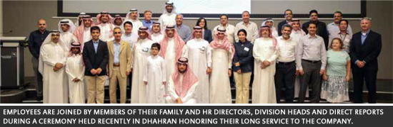 Employees are joined by members of their family and HR directors, division heads and direct reports during a ceremony held recently in Dhahran honoring their long service to the company.