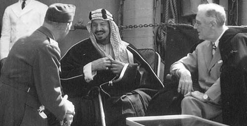 Eddy at left, translating for Ibn Saud and FDR in 1945