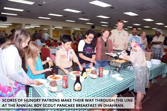Scores of hungry patrons make their way through the line at the annual Boy Scout Pancake Breakfast in Dhahran.