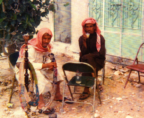 Arabic men smoking pipe