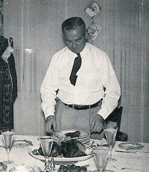 Ken Webster serves the traditional standing rib roast at the Webster family's annual Christmas Eve dinner in Dhahran, early 1950s.