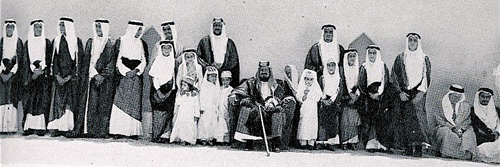 King Ibn Saud, seated in the center, surrounded by his sons, circa 1950.