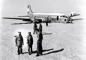 Saudi Arab guards near the KLM passenger plane that crash-landed in the desert near Dhahran on January 2, 1953.