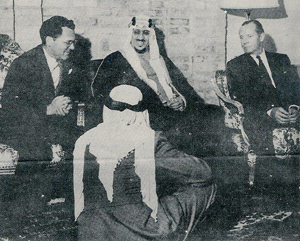Clipping from the Arabian Sun & Flare, showing Crown Prince Saud visiting with U.S. Consul-General Max Bishop and Aramco President R. L. Keyes.