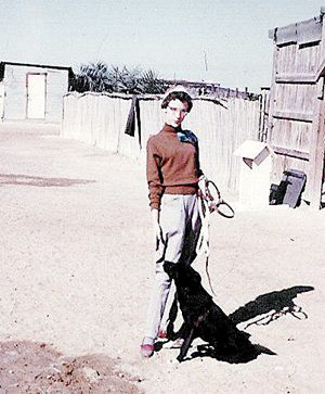 "Susan Webster, circa mid-1950s, at the Hobby Farm with ""Buttons,"" her pet Saluki."