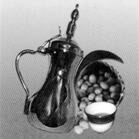 Traditional Arab coffee pot and dates.