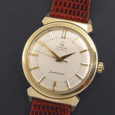 A gold 1950's Omega Seamaster watch