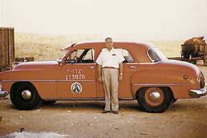 Dhahran District Manager Ken Webster with his Aramco car, mid-1950s.